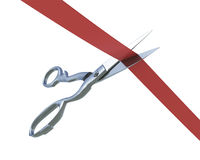 Scissors cutting a ribbon Royalty Free Stock Image