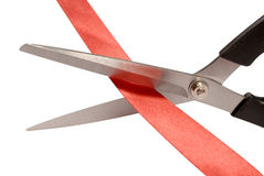 Scissors cutting ribbon or red tape on white Royalty Free Stock Photos