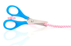 Scissors cutting the rope Royalty Free Stock Photo