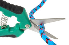 Scissors cutting the rope Stock Photography