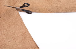 Scissors cutting sackcloth material Stock Photos