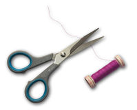 Scissors cutting thread. A pair of scissors cutting pink sewing thread Royalty Free Stock Photography