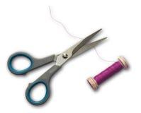 Scissors cutting thread Royalty Free Stock Photography