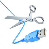 Scissors cutting the USB cable Royalty Free Stock Photo