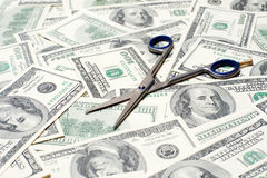 Scissors on the dollar background Stock Photo