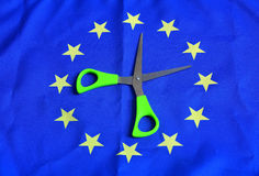 Scissors euro flag. Scissors and euro flag. On a european flag Royalty Free Stock Photography