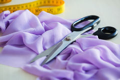 Scissors and a fabric Royalty Free Stock Photo
