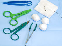 Scissors, forceps, surgical gauze, suture needle Stock Image