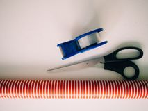 Scissors, frieze and wrapping paper to prepare Christmas gifts royalty free stock photos