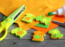 Scissors, glue , sheets of felt, decorative  with miniature bunnies. Royalty Free Stock Images