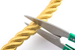 Scissors and golden rope Stock Images