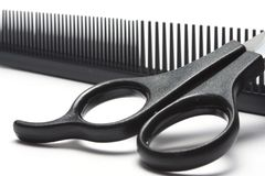 Scissors and hairbrush Stock Photography