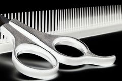 Scissors and hairbrush Stock Photo