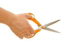 Scissors in hand Royalty Free Stock Image