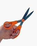Scissors in hand. Hand holding scissors Royalty Free Stock Photography