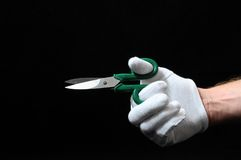 Scissors and a Hand Stock Photography