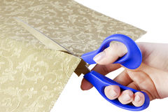 Scissors in hand cut fabric Stock Photo