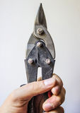 Scissors in hand Royalty Free Stock Images