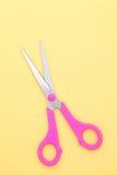 Scissors. Handled scissors on yellow background Stock Photo