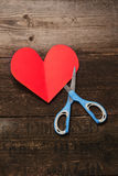 Scissors, and the heart of the paper Stock Image