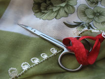 Scissors and lace. Scissors on scarf with lace Stock Images