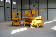Scissors lift platforms. New factory hall with hydraulic scissors lift platforms Stock Photo