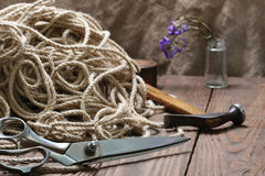Scissors matted jute rope and a hammer Stock Photography