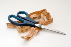 Scissors and measuring tape Royalty Free Stock Image