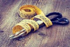 Scissors and measuring tape Stock Photo