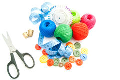 Scissors, meter, colored buttons, thimbles and thread Stock Photos