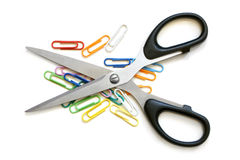 Scissors and multicolored paper clips Royalty Free Stock Images