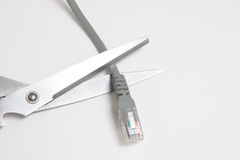 Scissors and network cable Royalty Free Stock Images