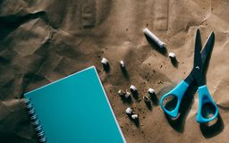 Scissors, blue notepad, cutted cigarette,world no tobacco day. Scissors, notepad, cutted cigaretteworld no tobacco day royalty free stock image