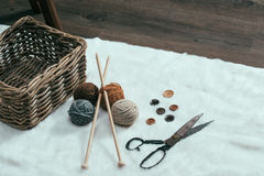 Scissors, old basket and yarn ball on carpet Royalty Free Stock Images