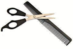 Scissors over comb haircut Stock Photos