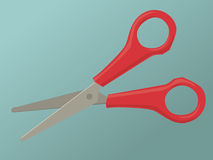 Scissors. A pair of red scissors in an open position Royalty Free Stock Image