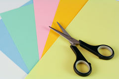 Scissors with paper. Coloured paper with a pair of scissors Royalty Free Stock Photography