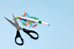 Scissors and paper clips Royalty Free Stock Images