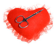 Scissors on the plush heart Stock Photography