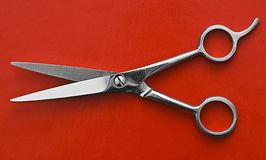 Scissors on red background. A pair of Scissors on red background Stock Photography