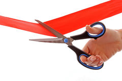 Scissors and red ribbon Stock Images