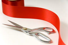 Scissors and red ribbon Royalty Free Stock Photography