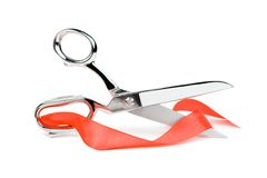 Scissors with red ribbon. Metal scissors with red ribbon. Isolated on white Royalty Free Stock Photography