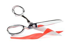 Scissors with red ribbon Stock Photos