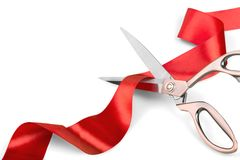 Scissors Cutting Red Ribbon. Scissors red ribbon close-up closeup cutting isolated ribbon stock images