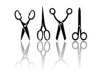 Scissors with reflection silhouette Stock Photos