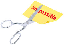 Scissors remove the word impossible to read possible Royalty Free Stock Photos