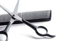 Scissors resting on barber comb closeup Stock Image