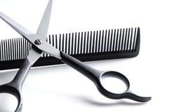 Scissors resting on barber comb closeup Stock Image