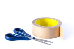 Scissors and a roll tape Royalty Free Stock Photography